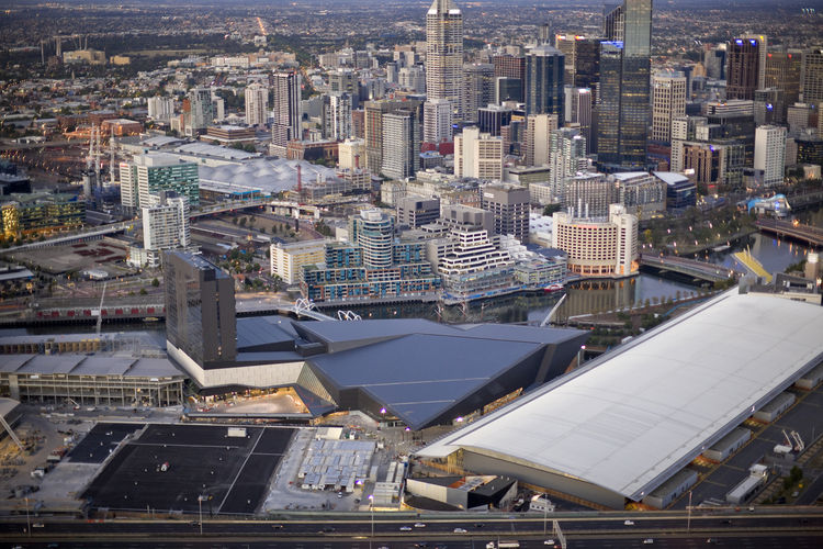 Viewed from high above, you can see how the Convention Center (black roof) sits nestled between Melbourne Exhibition Center—the massive white roof in the foreground—and the tower of the new HIlton Hotel, part of which is still under construction. Elements