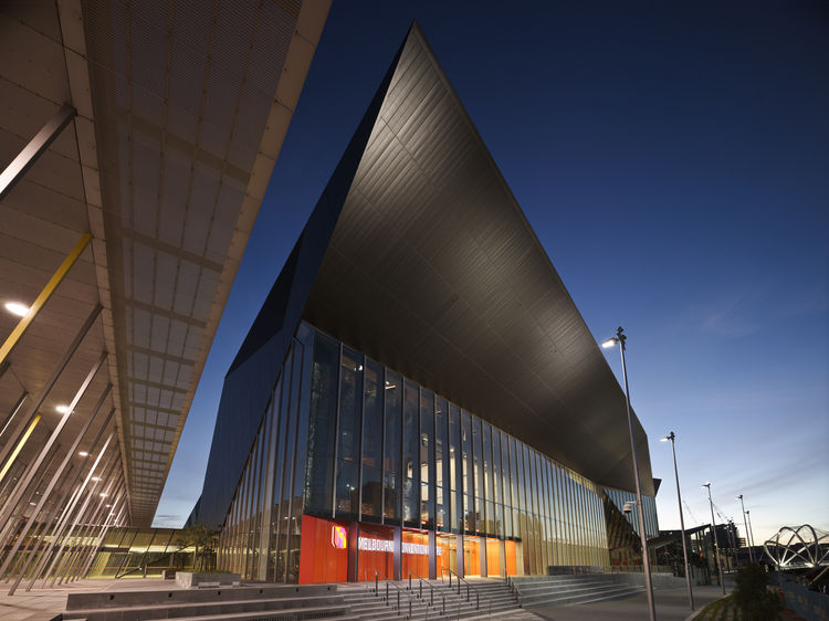 "Though the structure of the Convention Center is steel, it's the black zinc that defines its facade. This huge cantilever extends 40 meters out over the courtyard to provide shelter for any outside exhibitions.<p></p>Image courtesy <a href=""http://www.dwe"