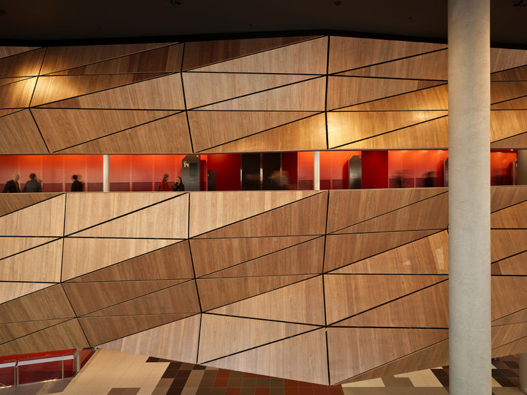 Here's another view of the pineapple wall on the interior of the building. The black zinc facade of the building is also a series of triangular panels (the same is true of the fractal facades at the city's Federation Square, actually). I really like the a