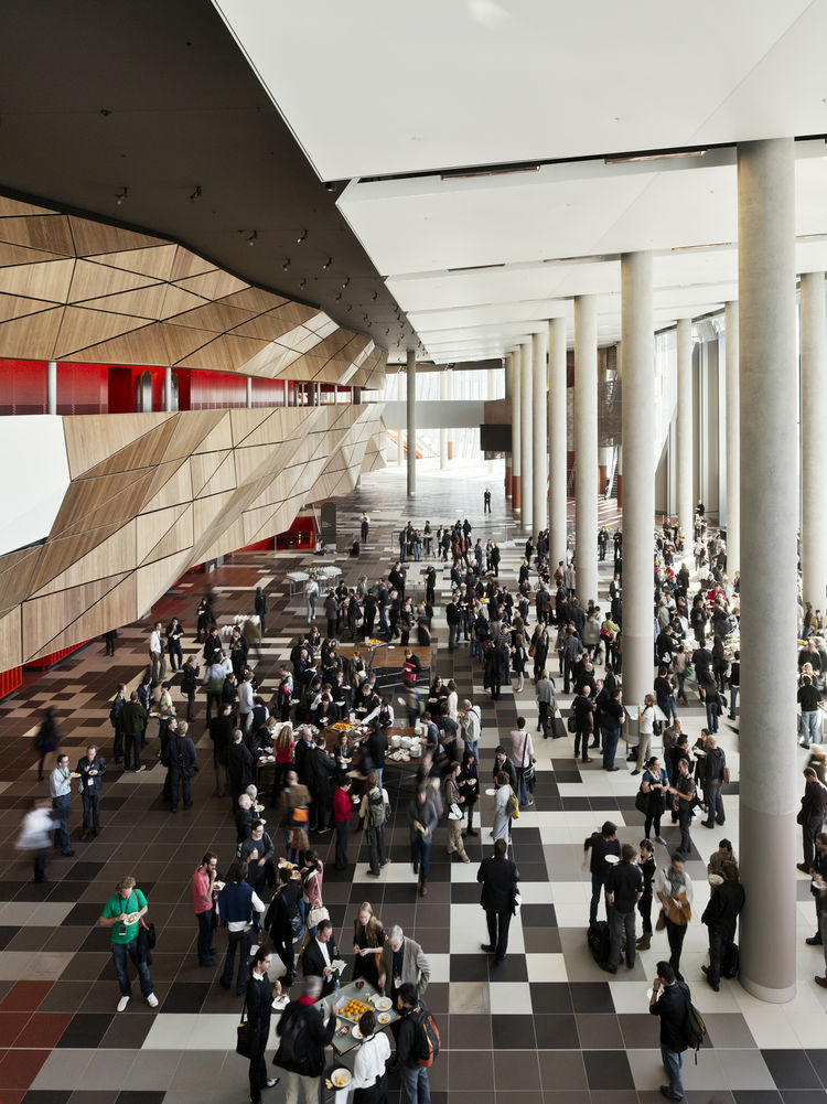 In this shot you can see the copious amount of natural light that floods into the foyer and halls of the Convention Center. Not only does this help keep energy costs down, but it allows visitors to actually look out and see the city of Melbourne. Out the