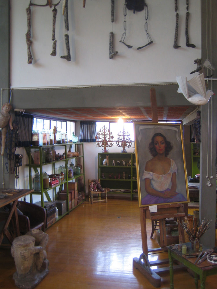 Here you can see into the nook off the main space. A painting by Rivera is shown as well as some shelves for the his collections of dolls and other crafts.