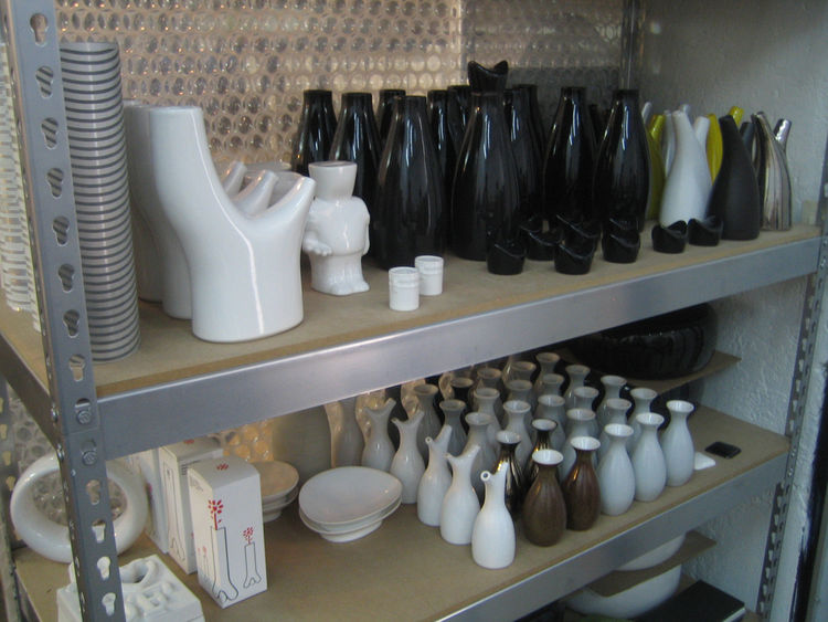 Here's a shelf in Ariel's studio filled with his products. Some are test cases, others finished and others still packaged up and ready to go.
