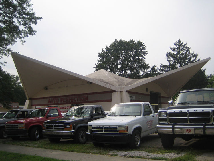 The sides of the building used to be open, but this auto service shop is a Dow design is of Styrofoam and concrete.