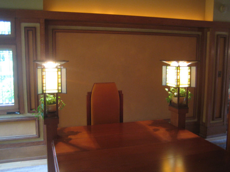One of the amazing details in the Meyer May house is a quartet of lamps at each corner of the dining table. They create quite an intimate glow and encourage the diners to huddle in. The table itself was quite large, though once the leaves are taken out it
