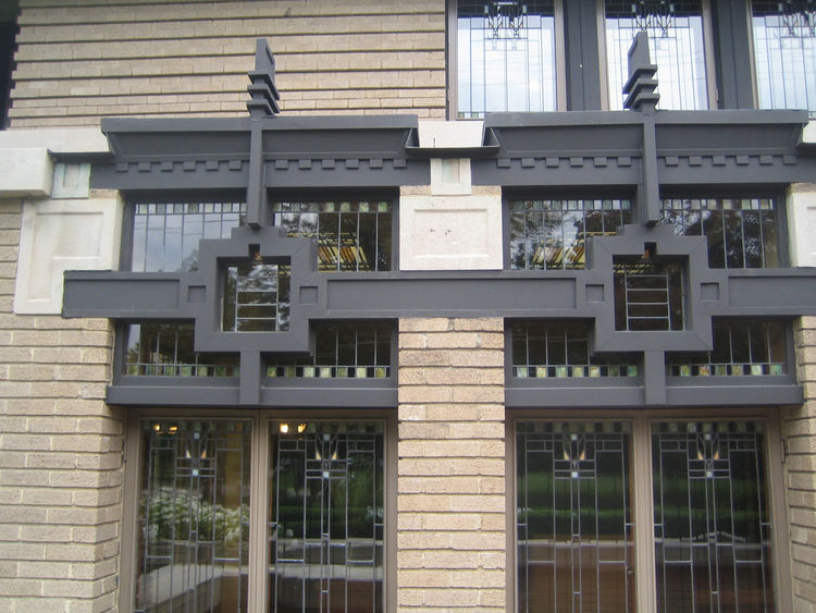 Here's a detail from the facade that I really liked. The house has a very lateral orientation and is a fine example of Wright's Prairie Style. It was hard to get a full photo of it from the street, though seeing all massive Georgian, Federal, and Victoria