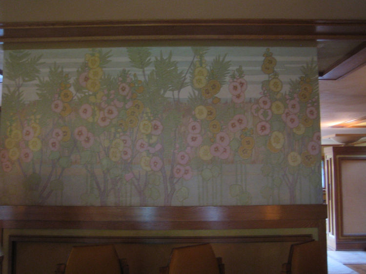Another great detail is this mural that wraps around a wall that faces both the foyer and dining room. The Steelcase restorers found it under layers and layers of paint and found a concurrent work by artist George Niedecker on which to model the retouchin