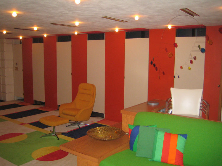 Here's another view of the downstairs playroom. It also doubles as a theater where the Dows would show movies or films Alden made of his travels and work.