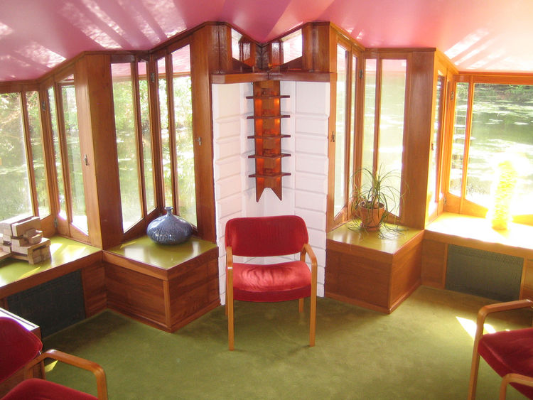 As you enter the home and studio you are led down a small flight of stairs to the Submarine room, which is just about flush with the level of the pond. The pink ceilings refract the light off the water and the open windows really put you straight out on t