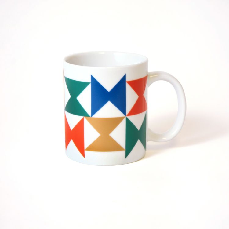 A boldly colored ceramic mug, with a pinwheel pattern for Georg Jensen tableware that was used at the Miller House.