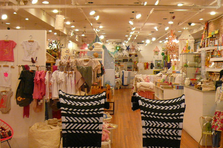 And then just beyond the African chairs, a pastel wonderland of baby's clothes. Bizarre! But somehow mesmerizing.
