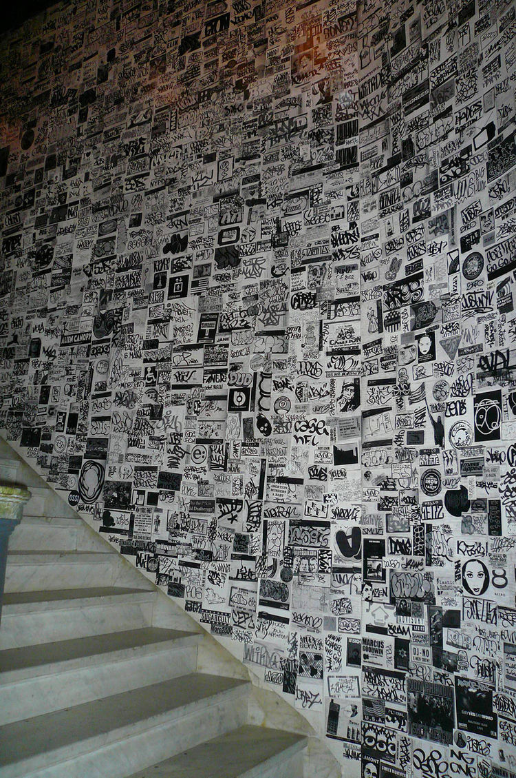 The staircase leads away from the lobby with a big street-art-inspired wall.