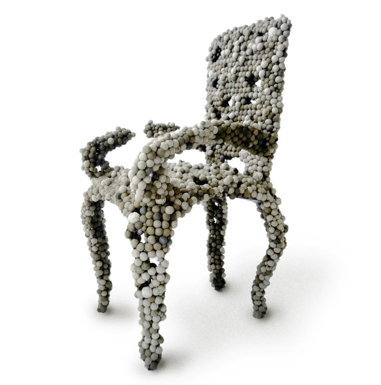 "The Molecular chair looks as though it's made of just that: molecules blown up millions of times, hanging onto each other in waving strands. The ""molecules"" in this case are felt balls attached to a wire mesh frame. Photo courtesy of Industry Gallery."