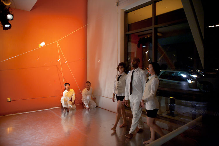 Here's a view of the cafe space from the interior. Continuing the same vein as earlier in the performance, as the three dancers at right danced, the two crouching in the corner manipulated a string hung from another. It was a more physical ordering of spa