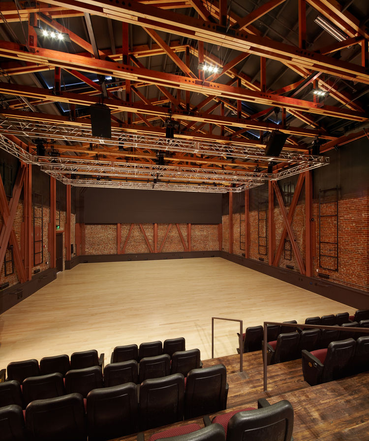 The performance last night ended in the main auditorium space, which is massive compared to the studio spaces. Though I couldn't see them in action, there are actually many skylights in the ceiling allowing natural light into the windowless space. The ste