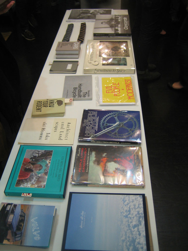 The center aisle of the shop was taken up by two tables filled with books and printed matter. The best of this lot was a small book of the architectural photos of Takashi Homma.