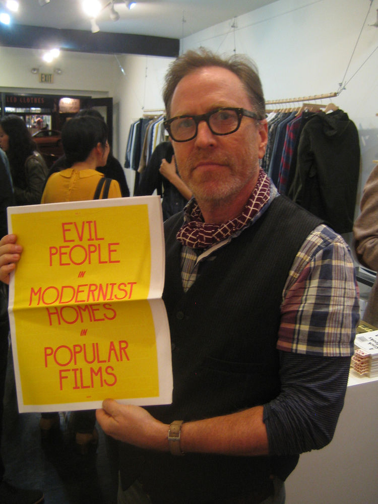 "Larry Schaffer is holding up a great tabloid from the pop-up shop. He called the selection of goods a ""tight, holiday edit of what is our best, simple, understated gift items."""