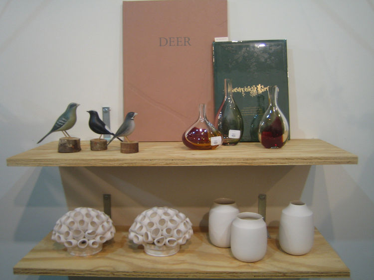 A fine example of the mix of decorative objects, tabletop good, and books in the show.