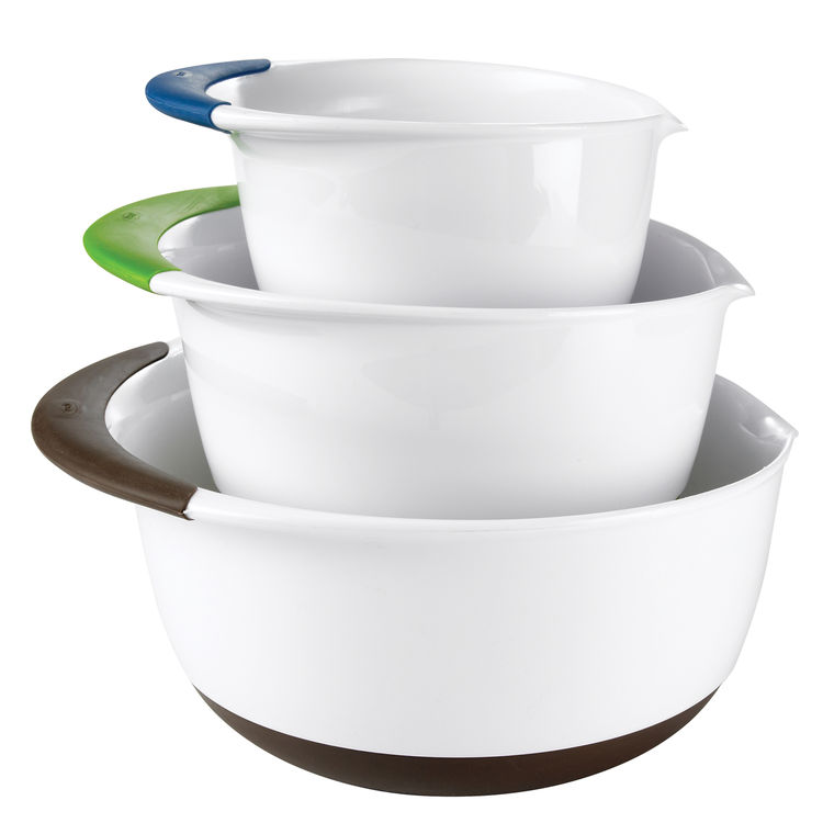 Mixing bowls are ubiquitous. These ones stand out with their small details. The one-and-a-half-, three-, and five-quart bowls feature nonslip handles and bases as well as spouts for pouring. They are color-coded by size and nest away for space-saving stor
