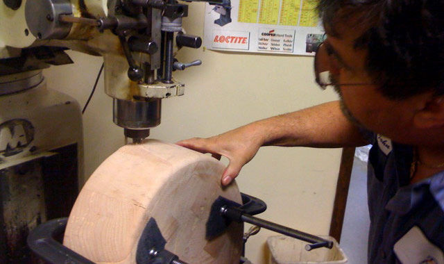 """""""My father, John Ribic Sr., cuts the slots for the legs of the stool."""""""
