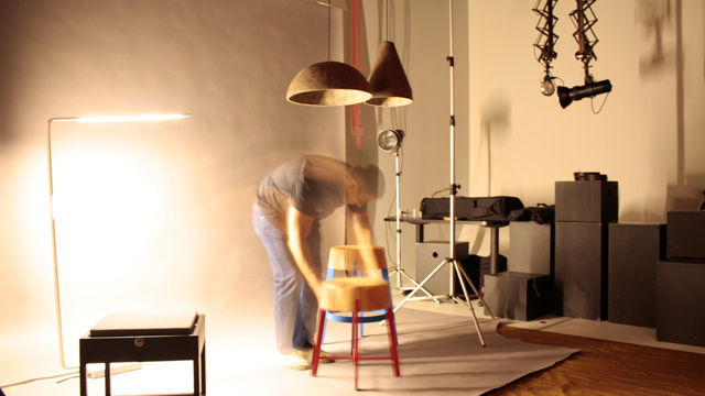 Ribic sets the scene for a photo shoot for Cleveland's Plain Dealer newspaper.  Also featured in the shot is Objeti's LED Hangman lamp.