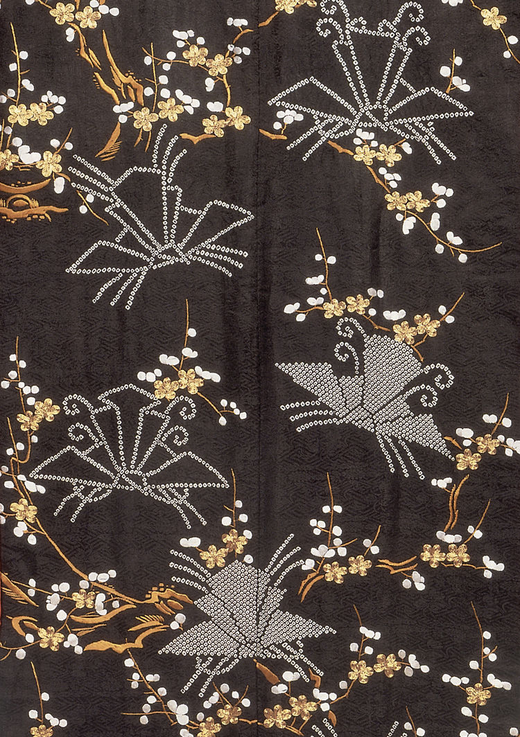 Outer kimono, monochrome figured satin silk with tie-dyed and embroidered decoration. Japan, 1800-30 (V&A: FE.28-1984). From <i>V&A Pattern Series II: Kimono</i> published by V&A Publishing and Abrams Books.