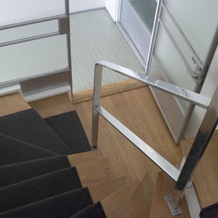 "One architect I met, Sylvia Kwan of Kwan Henmi, remarked that the railing on the stairwell was very ""moderne"" and she was absolutely right. Though the dominant feeling in the house was that of a modern row house with the occasional LA accent, there were f"