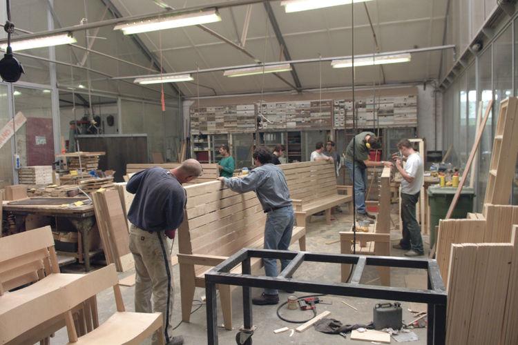 Eek's team assembling wood in the studio