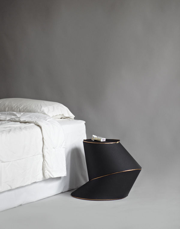 Aranda/Lasch's piece is made from a single ten-foot-long gold zipper, black leather, and a vinyl composite structure. The piece unzips to reveal a dark pink velvet lining.