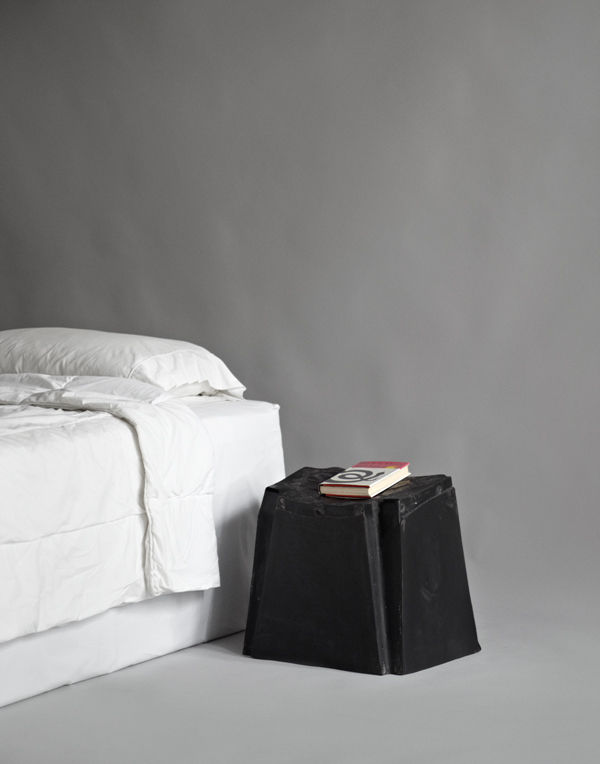 """To create this bedside table, musician Michael Stipe cast the underside of his """"cheap plastic chair"""" in a semi-soft, durable plastic typically used to make pickup truck bed liners."""