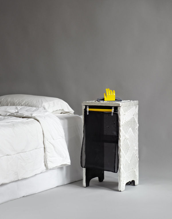 A mixed-media nightstand by Paul Kopkau has a surrealist look about it.