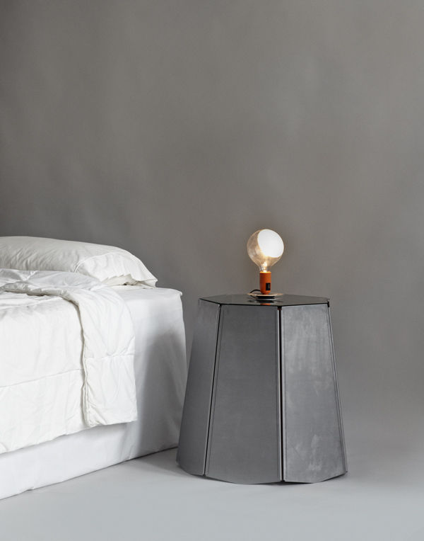 Rich Brilliant Willing's piece, assembled from brushed aluminum, belting leather, and glass, forgoes storage space entirely, acting simply as a handsome bed-high table surface.