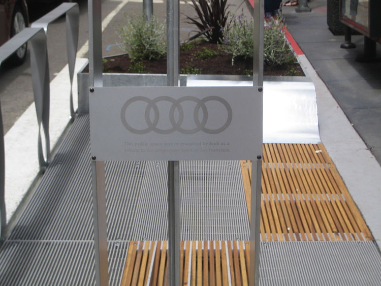 "Here's the only real Audi branding on the eight parklets. It's a plaque on one of the solar collectors. I talked with Audi PR man Andrew Lipman and he told me that the car company loves this project because, ""It's a project that solves a problem and gives"