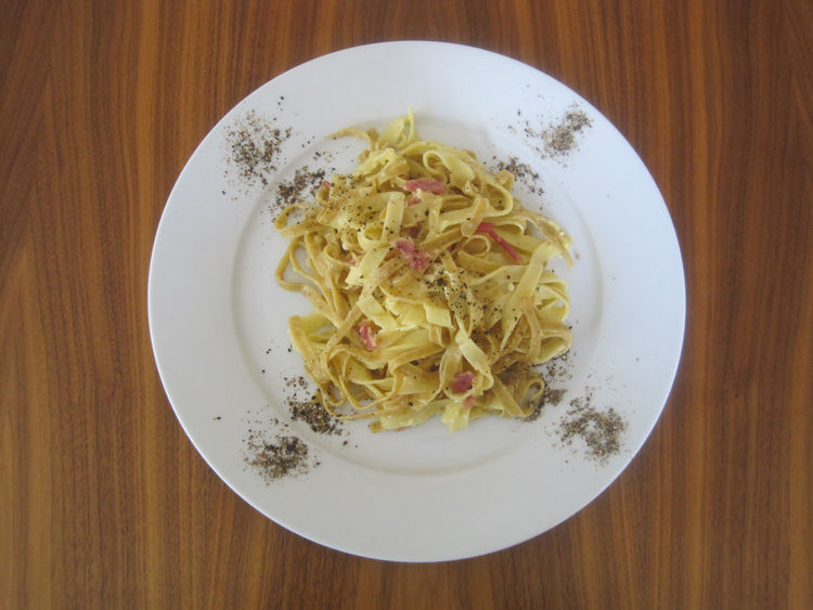 Anne's homemade pasta carbonara, plated with her requisite generous serving of black pepper.