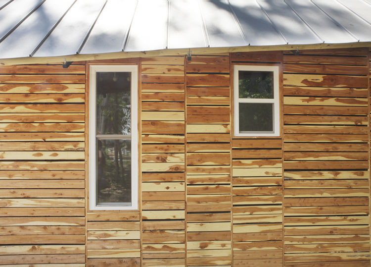 "<p>The students also attempted to appease residents by making their home ""of the area."" They based the design on vernacular shotgun houses and bought the cedar siding as off-cuts from a local lumberyard, which totaled $120.<br /> <br /> Photo by"