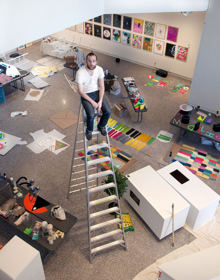"Illustrator Mike Perry at the Minneapolis College of Art and Design gallery in the midst of setting up his new show, <a href=""http://www.dwell.com/events/lost-in-the-discovery-of-what-shapes-the-mind-.html""><i>Lost in the Discovery of What Shapes the Mind"