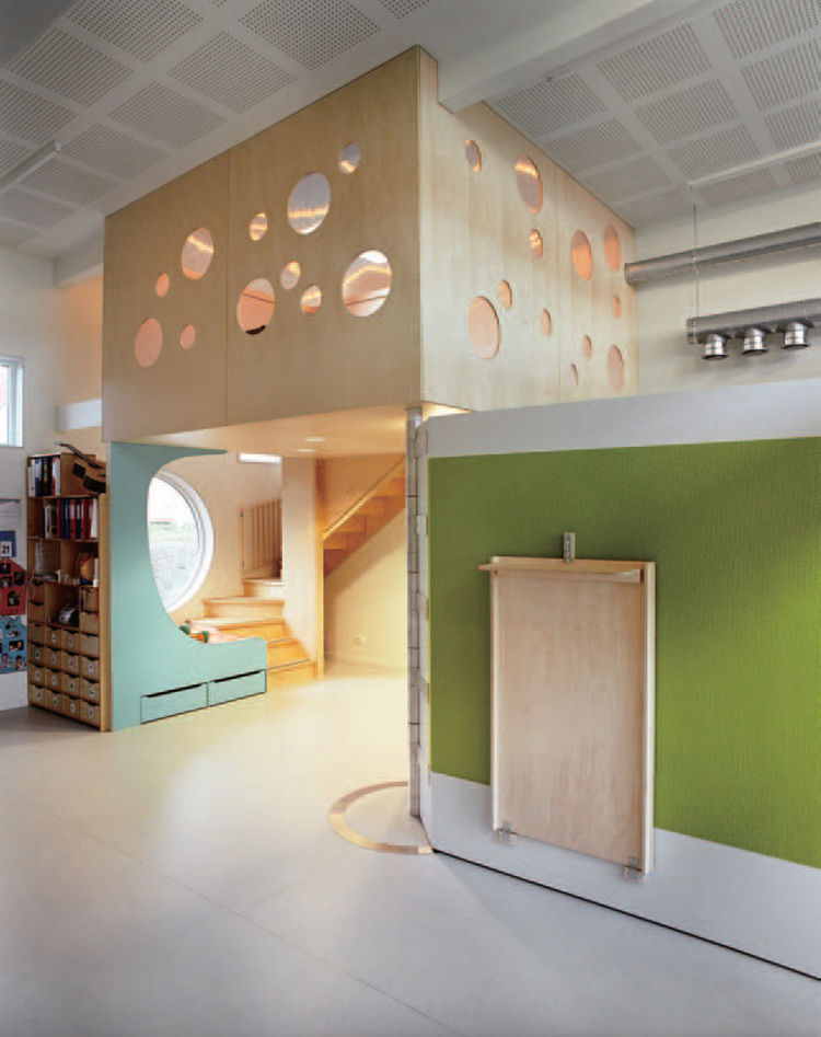 Several of the Tromsø kindergartens feature hinged walls, like the one shown here. These movable partitions create the opportunity to divide spaces into large or small areas. The walls also feature built-in furniture, drawers, whiteboards, climbing walls,
