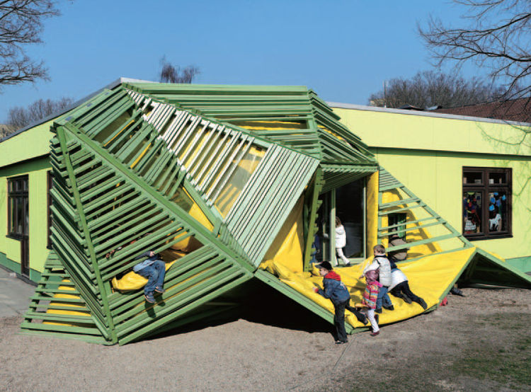 How fun is the Tuka-Tuka-Land kindergarten in Germany? Designed by Die Baupiloten, the building features irregular climbing and hiding structures that burst out of the exterior walls.