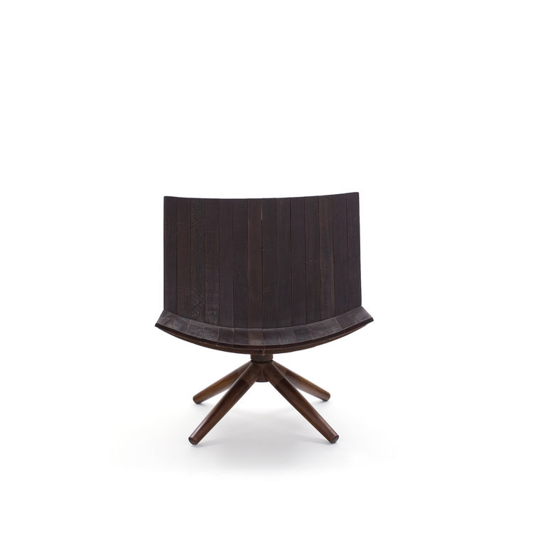 """""""I called this chair Radar, because the back rotates around its pivot point and reminds me of a radar device,"""" says Motta. Designed in 2008, the chair is made of peroba rosa and oxidized iron. Photo courtesy <a href=""""http://espasso.com/home.asp"""">Espasso</"""