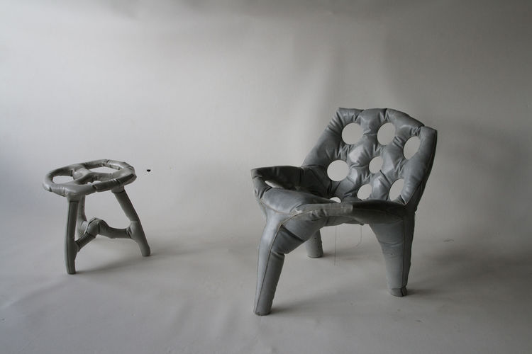Here we see the chair and stool made of poured concrete on display in Washington DC.
