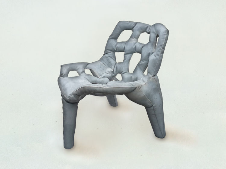 This chair of poured concrete is one of the prototypes on view at Industry Gallery.
