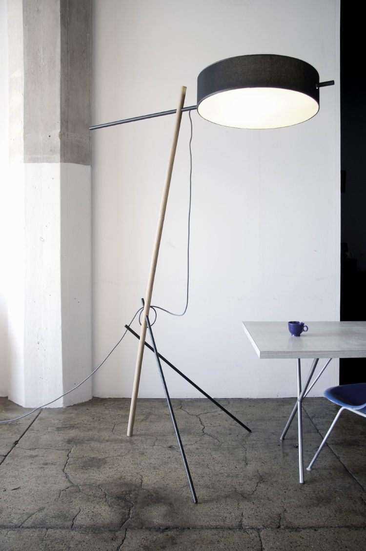 The Excel floor lamp comes flat-packed and used two CFL bulbs.
