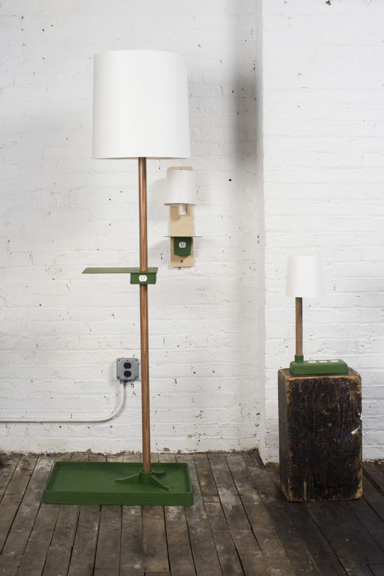 The Newtility line from Rich Brilliant Willing offers not just the functionality of a lamp, but a spot to rest a glass of water, and a place to plug in that perpetually-dying cell phone.