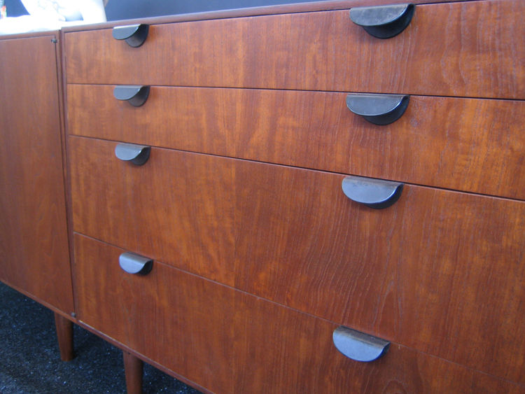 Here's a detail of the Juhl credenza. I love the pulls on the drawers. I was saying to Sarah that I have a soft spot for Cocteau (who gave the credenza as a present to a pal) yet I really dislike Andy Warhol. Odd considering their methods and brand of cel