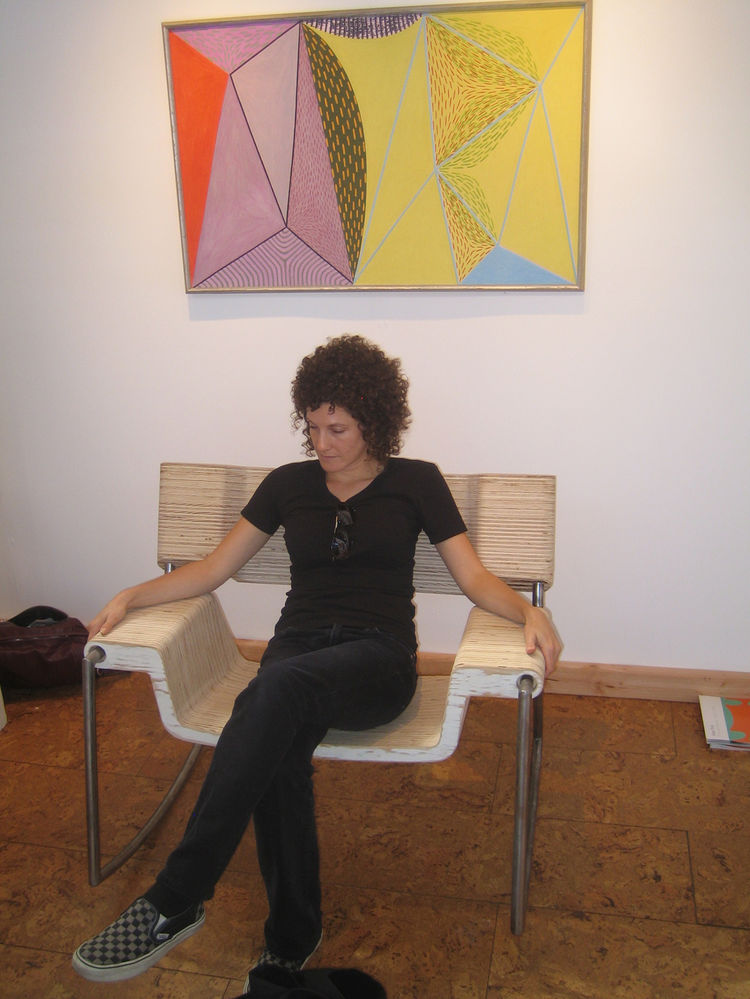 "Here's Sarah in the Houriet chair with a rather nice painting by Douglas Denniston from 1950 called ""Composition #35"" above her. We joked that the chair is nearly wide enough to be a loveseat, or a chair for a giant. -Aaron"