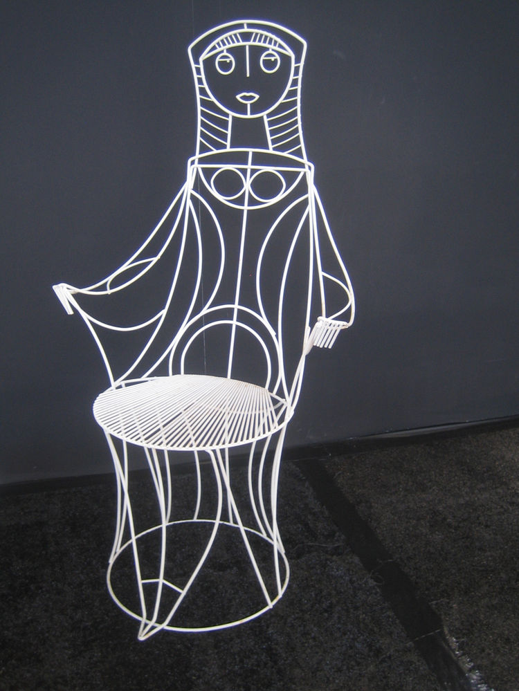 Here's a better view of just one of the chairs. The wire woman's hair reminds me of a nun's habit. -Aaron