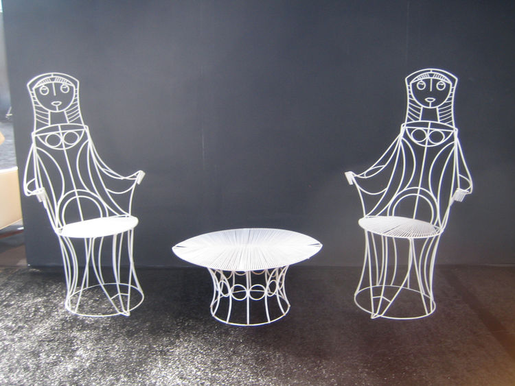 I loved this funny set of wire furniture designed in the 50's by John Rilsey. The Converso Gallery of Chicago was showing the chairs and they certainly added a bit of whimsy to the raft of sober, Scandinavian stuff I saw. -Aaron