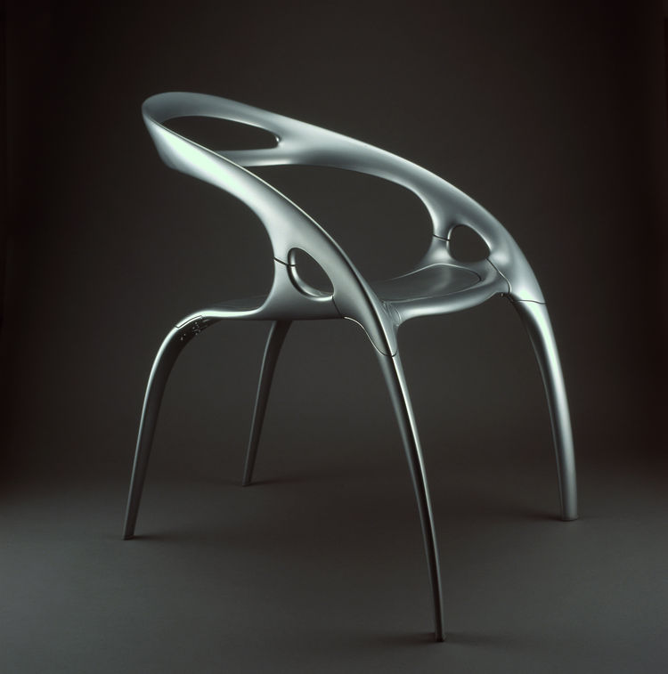 "Ross Lovegrove, who has referred to himself as an ""evolutionary biologist,"" designed the magnesium, aluminum and polycarbonate Go Chair in 1999. Lovegrove says the inspirations are ""body form, sensuality, anatomical base and high technology."" Photo by <a"