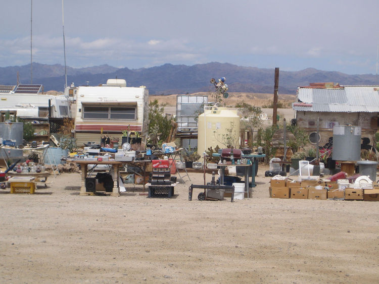 "Perhaps the oddest bit of our short time in Slab City was this purported ""yard sale."" Just tables and tables of dusty detritus with no one in sight. It made me imagine a wholly other economy exists there. And I suppose I wouldn't be too surprised if that'"