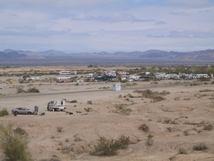 I took this photo from the top of Salvation Mountain looking out over Slab City. It's all that's left of an old Marine training ground and is now occupied by folk in RVs, tents, and the like. At one point the state tried to evict the people living there a