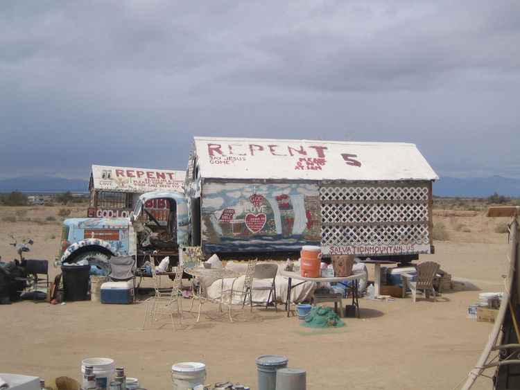 The large lot surrounding the mountain is littered with old cars and trucks and the stuff needed to make and maintain the mountain. Each has gotten the Salvation Mountain treatment of lots of paint and religious slogans. This is the truck where Leonard Kn